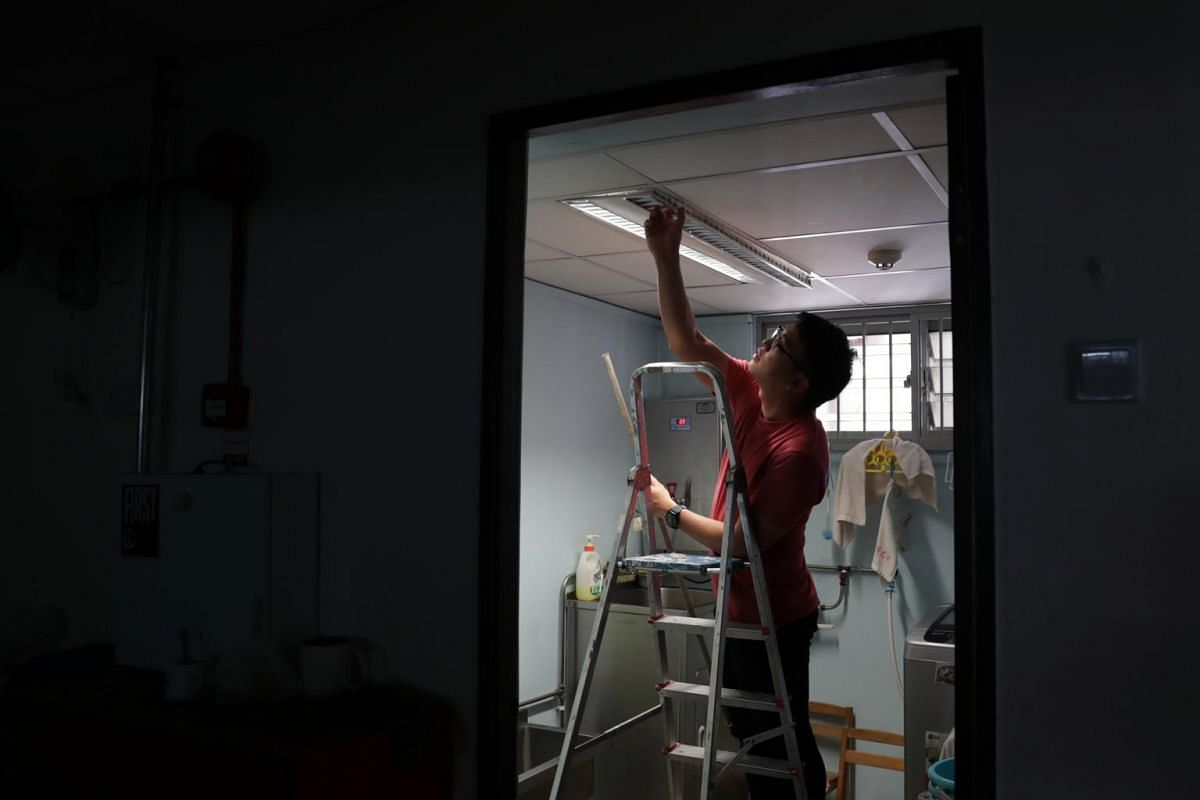 Mr Lim changes the lights in the pantry. Being the only male teacher in the school, he is the go-to handyman when there are things that need to be fixed.
