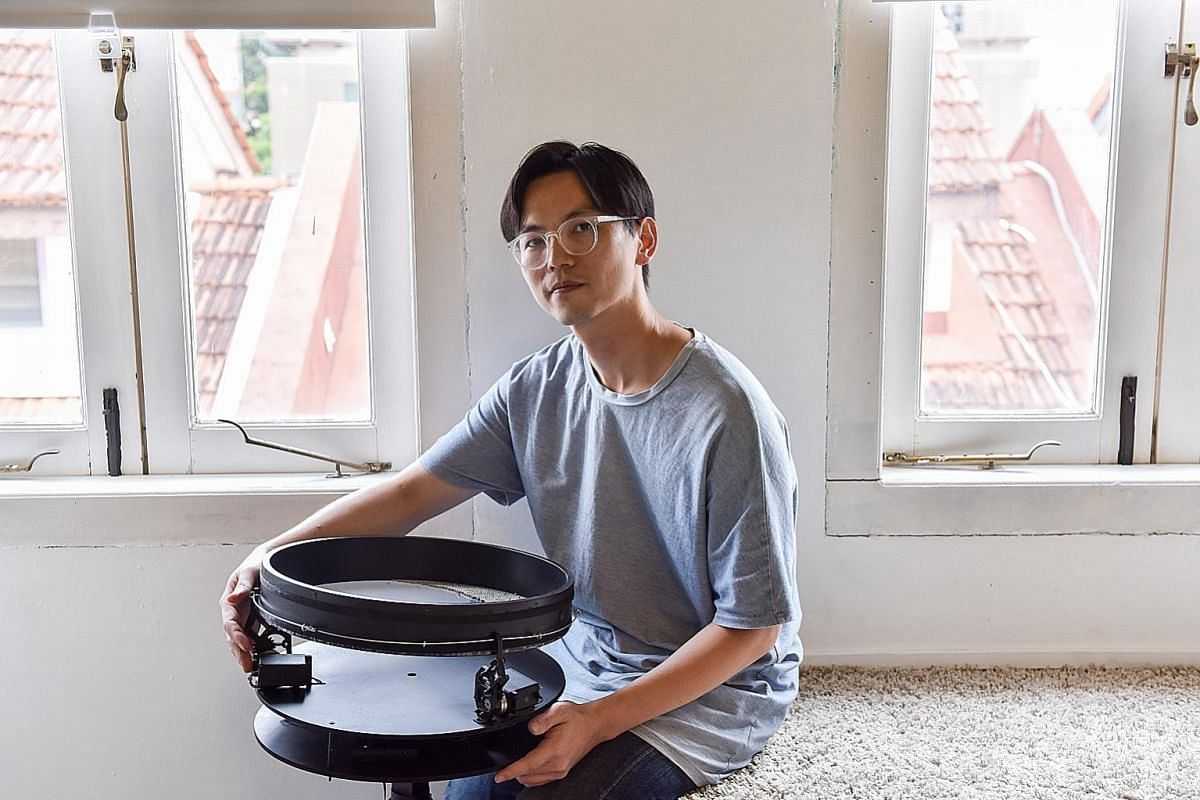 Media artist Ong Kian Peng with his kinetic sculpture, Coronado. Created in 2012, it mimics the sound of waves, which Ong was inspired by when he visited the Coronado beach in California. Spang & Lei's Wall Of Us art installation at the ArtScience Mu