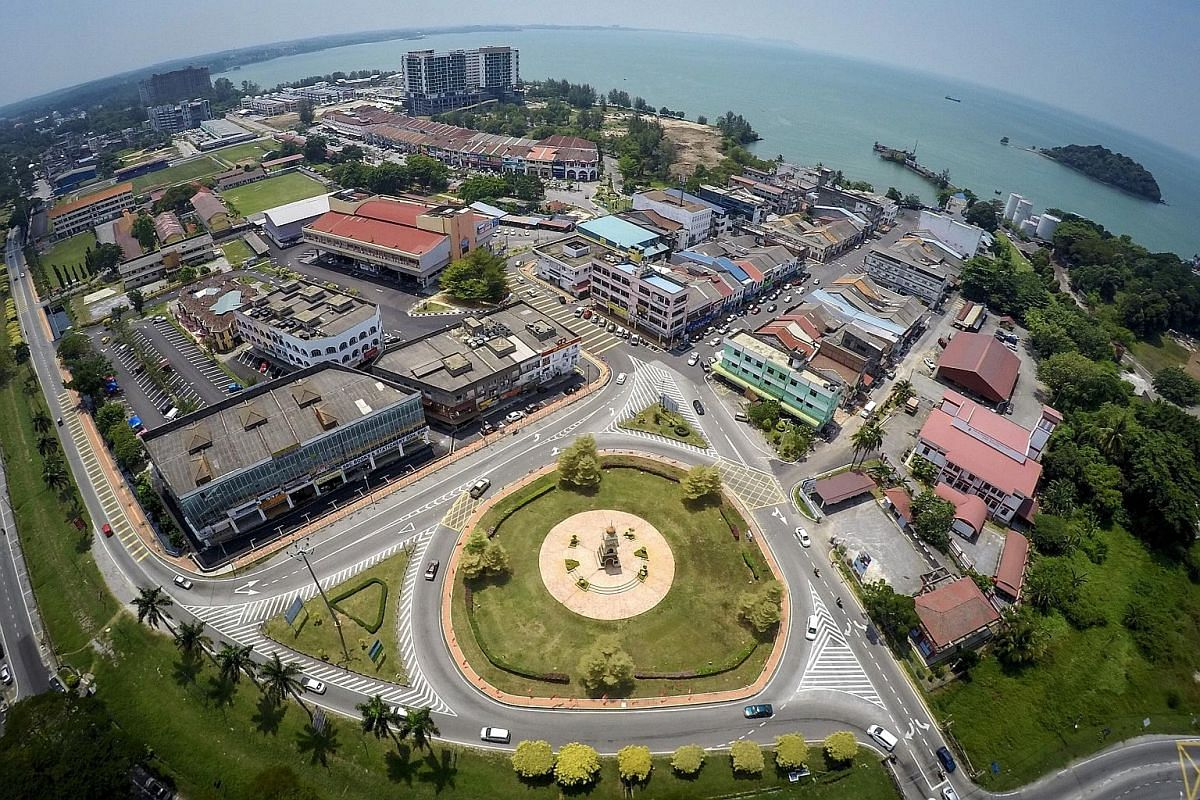 Left: An aerial view of Port Dickson, with hotels lining the more than 20km of beachfront (top left). It was a weekend draw for the middle class in its heyday. Mr Mohd Nazari Mokhtar, 57, is the Parti Islam SeMalaysia candidate for the Port Dickson b