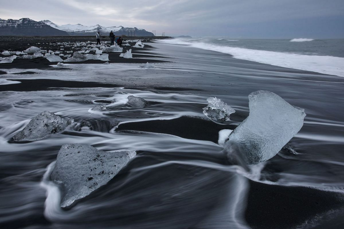 Chunks of ice are seen on Diamond Beach, where the Jokulsarlon glaciar lagoon meets the sea, along Route 1 between Hofn and Skaftafell in south-eastern Iceland, on Oct 8, 2018.
