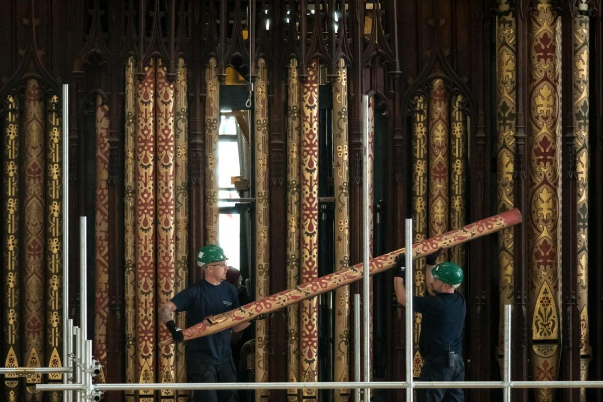 Organ refurbishment specialists begin to remove the pipes from York Minster's Grand Organ at the beginning of a once-a-century project to refurbish the instrument, in York, northern England on October 9, 2018. PHOTO: AFP