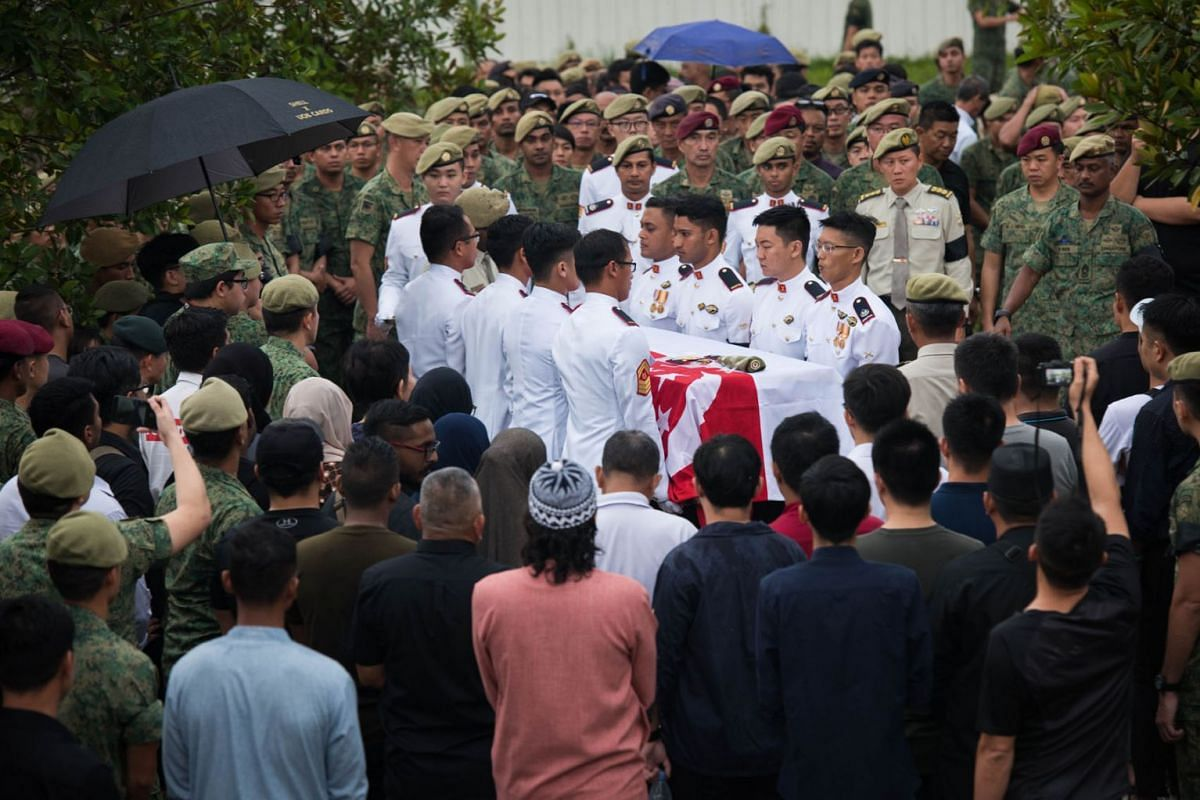 The body of 3WO Muhammad Sadikin Hasban being transferred to the burial site at Lim Chu Kang Muslim Cemetery on Oct 10, 2018. The SAF warrant officer died in Brunei after being hit by a falling branch while supervising contractors performing maintena