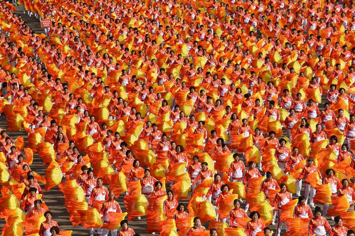 This photo taken on October 9, 2018 shows people taking part in a mass dance event in Datong in China's northern Shanxi province. PHOTO: AFP