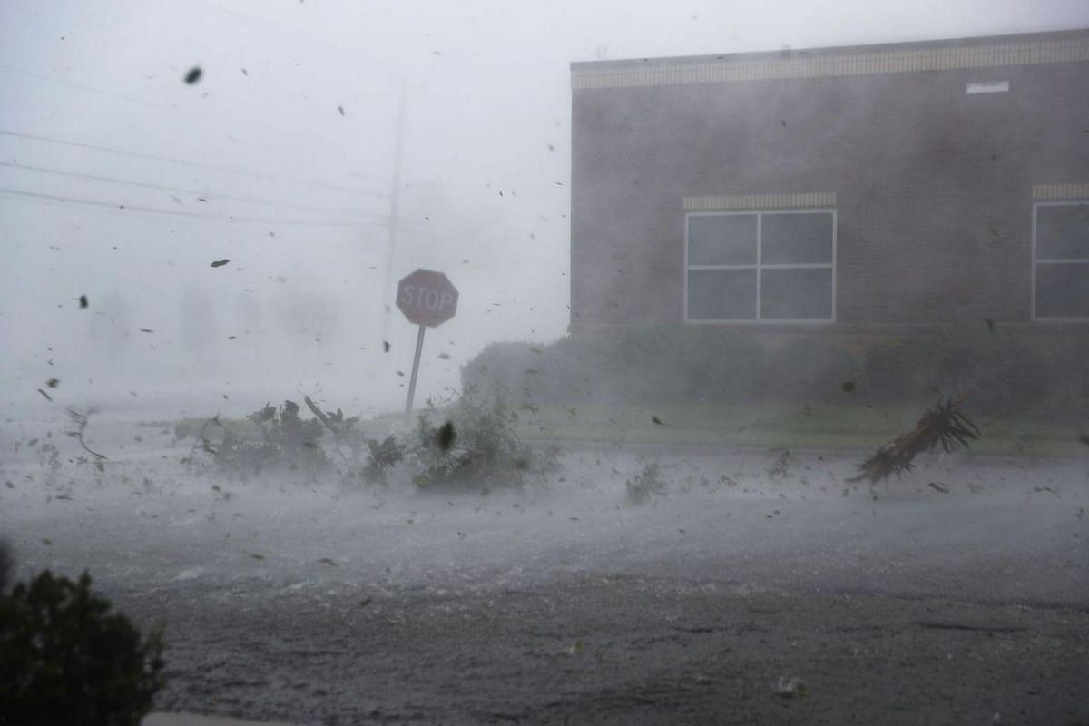 Debris is blown down a street by Hurricane Michael on Oct 10, 2018.