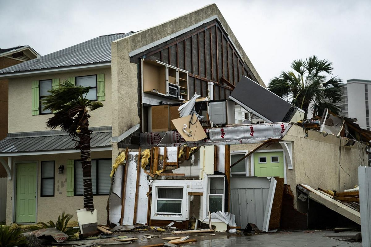 A home in Panama City Beach, Florida, is damaged by Hurricane Michael's winds.