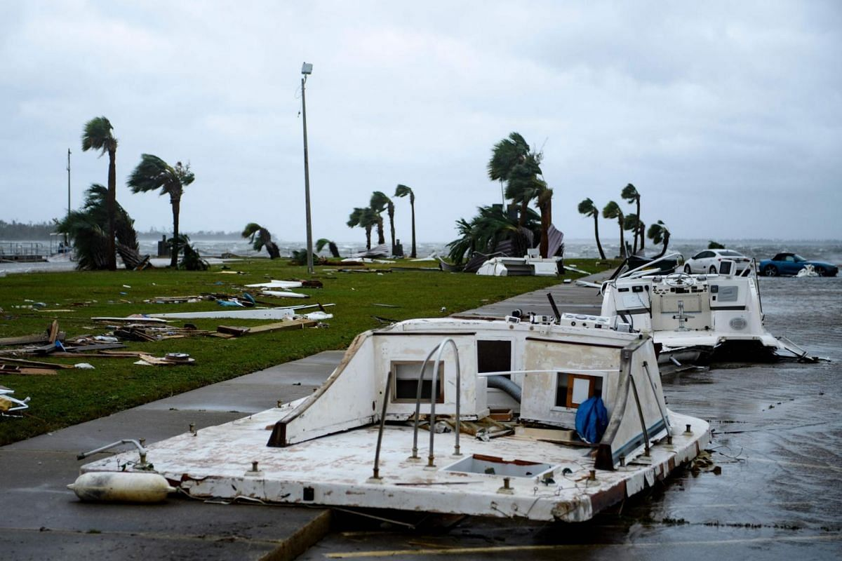 Damaged boats and cars are seen in a marina after Hurricane Michael on Oct 10, 2018, in Panama City, Florida.