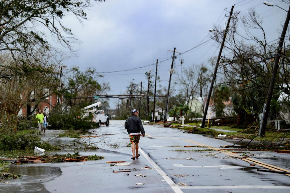 A man walks down the street after Hurricane Michael on Oct 10, 2018.
