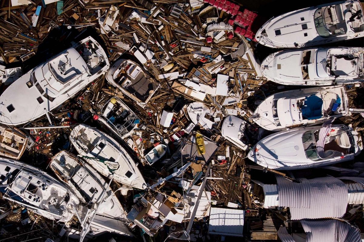 In this aerial view, storm damaged boats are seen in the aftermath of Hurricane Michael on October 11, 2018 in Panama City, Florida. PHOTO: AFP