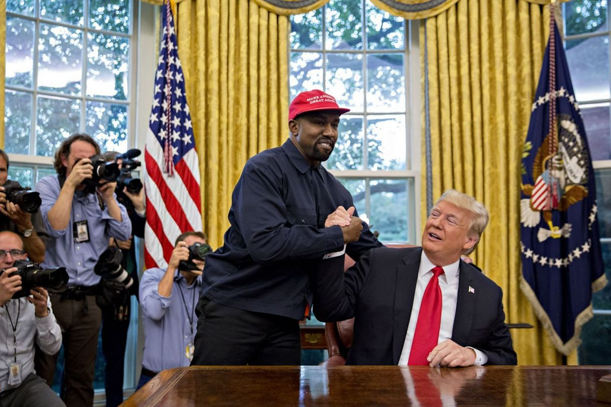 Rapper Kanye West shakes hands with President Donald Trump during a meeting in the Oval Office in the White House on Oct. 11, 2018. PHOTO: BLOOMBERG