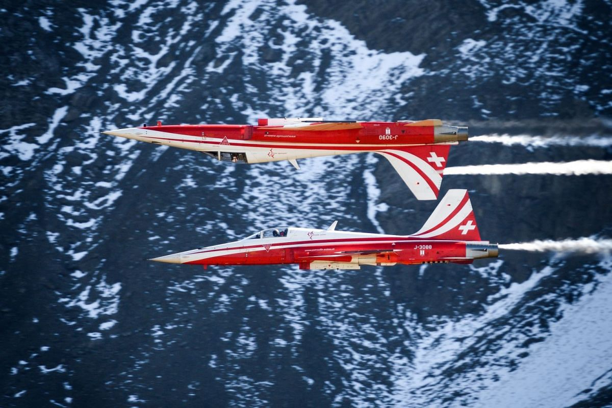 """Fighter jets of the """"Patrouille Suisse"""" (Swiss patrol) fly during the annual live fire event of the Swiss Air Force at the Axalp over Brienz in the Bernese Alps on October 10, 2018. PHOTO: AFP"""