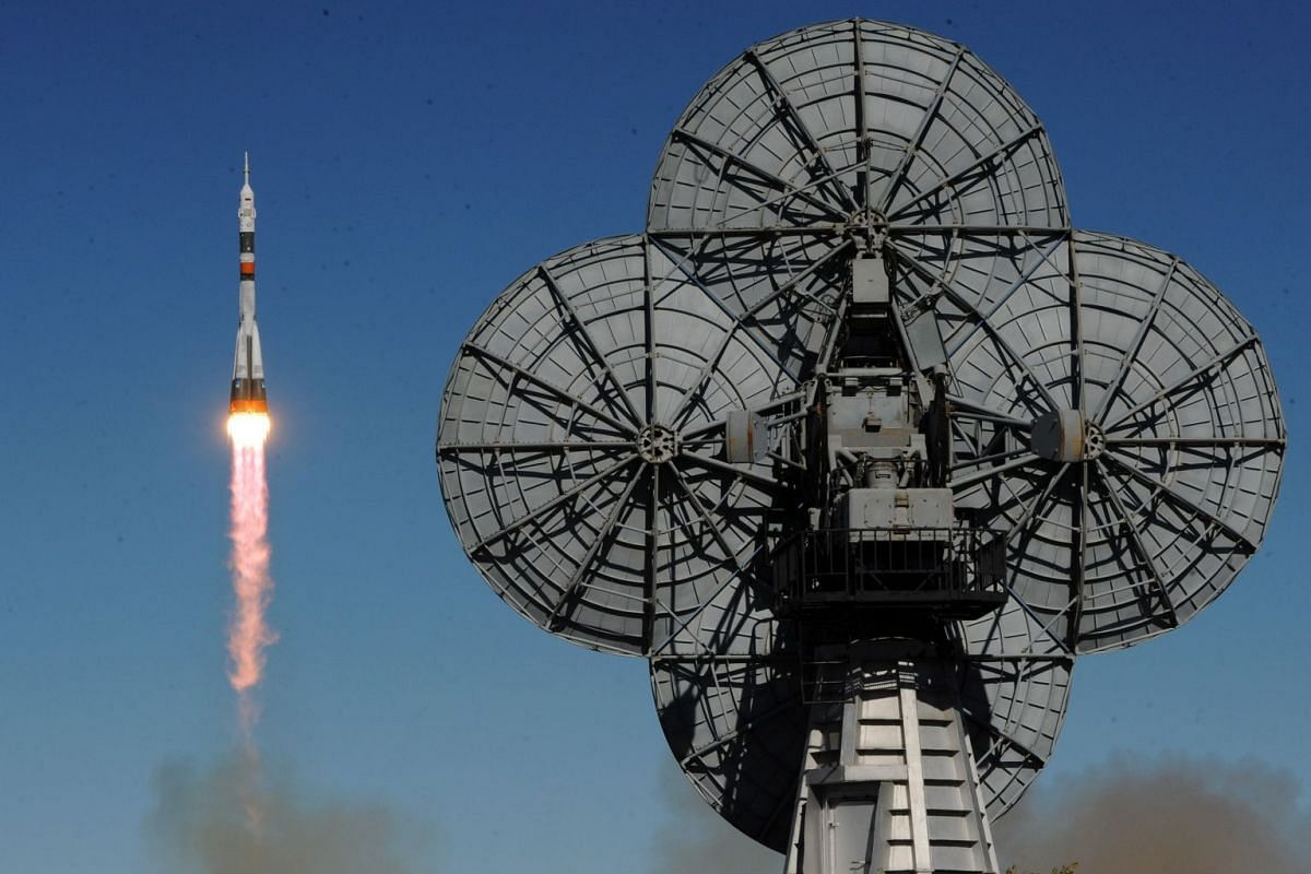 Russia's Soyuz MS-10 spacecraft carrying the members of the International Space Station (ISS) expedition 57/58, Russian cosmonaut Alexey Ovchinin and NASA astronaut Nick Hague, blasts off to the ISS from the launch pad at the Russian-leased Baikonur