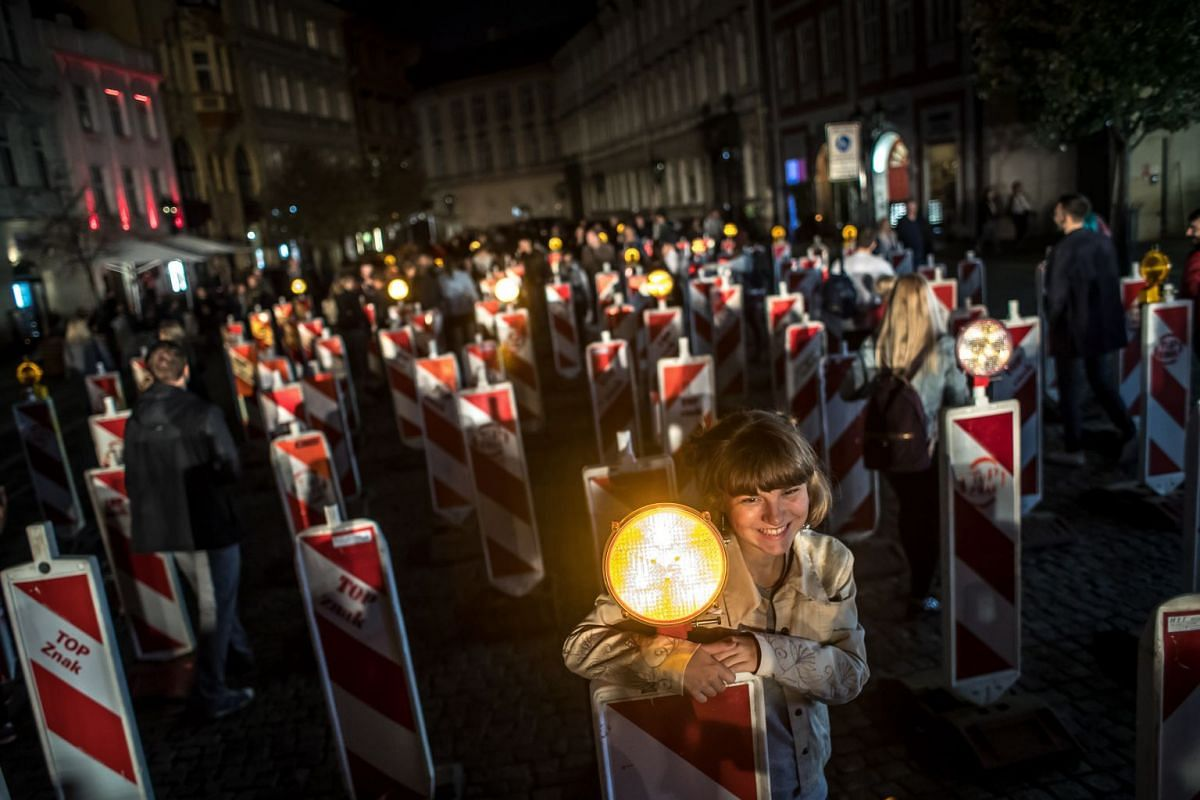 Visitors observe the light installation 'About Being In A Herd' during the Signal Festival in Prague, Czech Republic, October 11, 2018. PHOTO: EPA-EFE