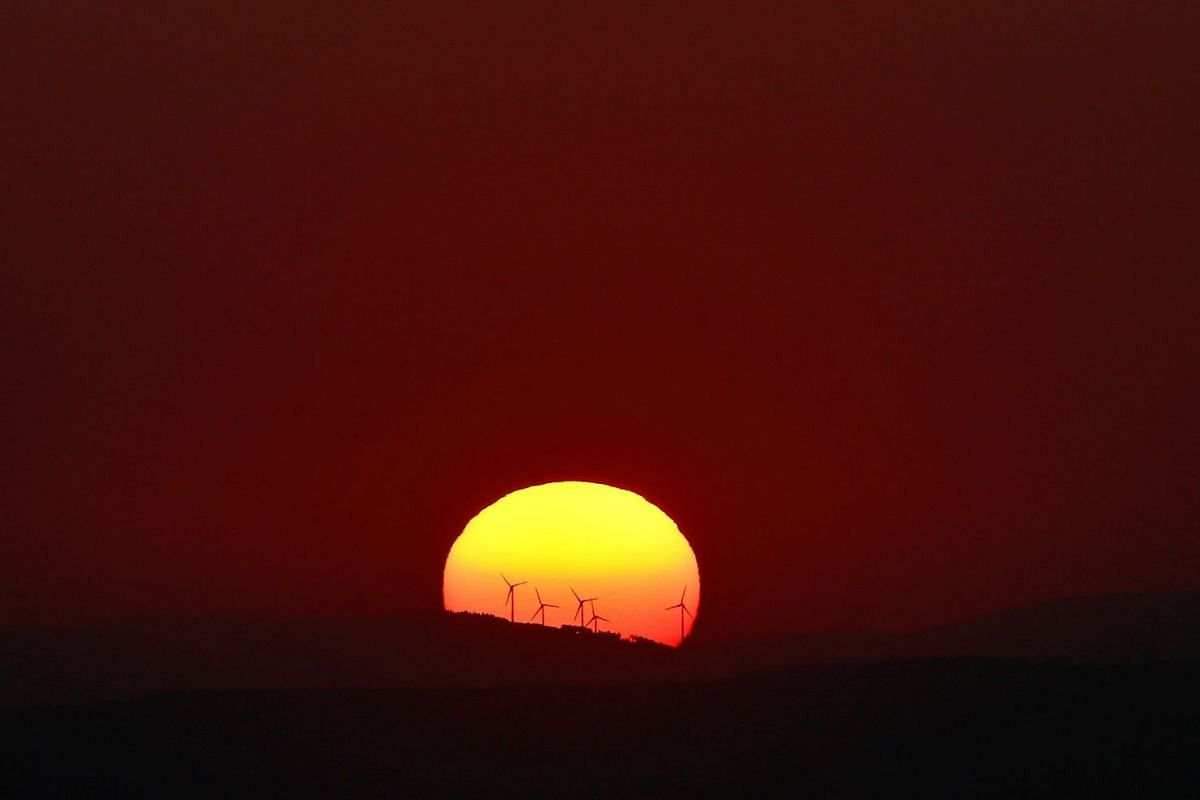 The sun sets early evening over the hills outside Frankfurt, Germany, October 10, 2018. PHOTO: REUTERS