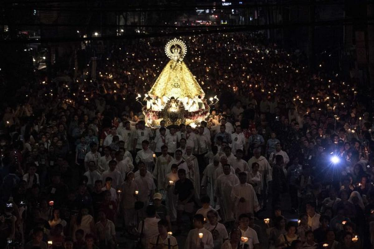 Christian devotees participate during the annual procession of Our Lady of the Holy Rosary La Naval de Manila on a street in Manila on Oct 14, 2018. The first procession was celebrated on Oct. 8, 1646 in Manila to mark the naval victory of the Spanis