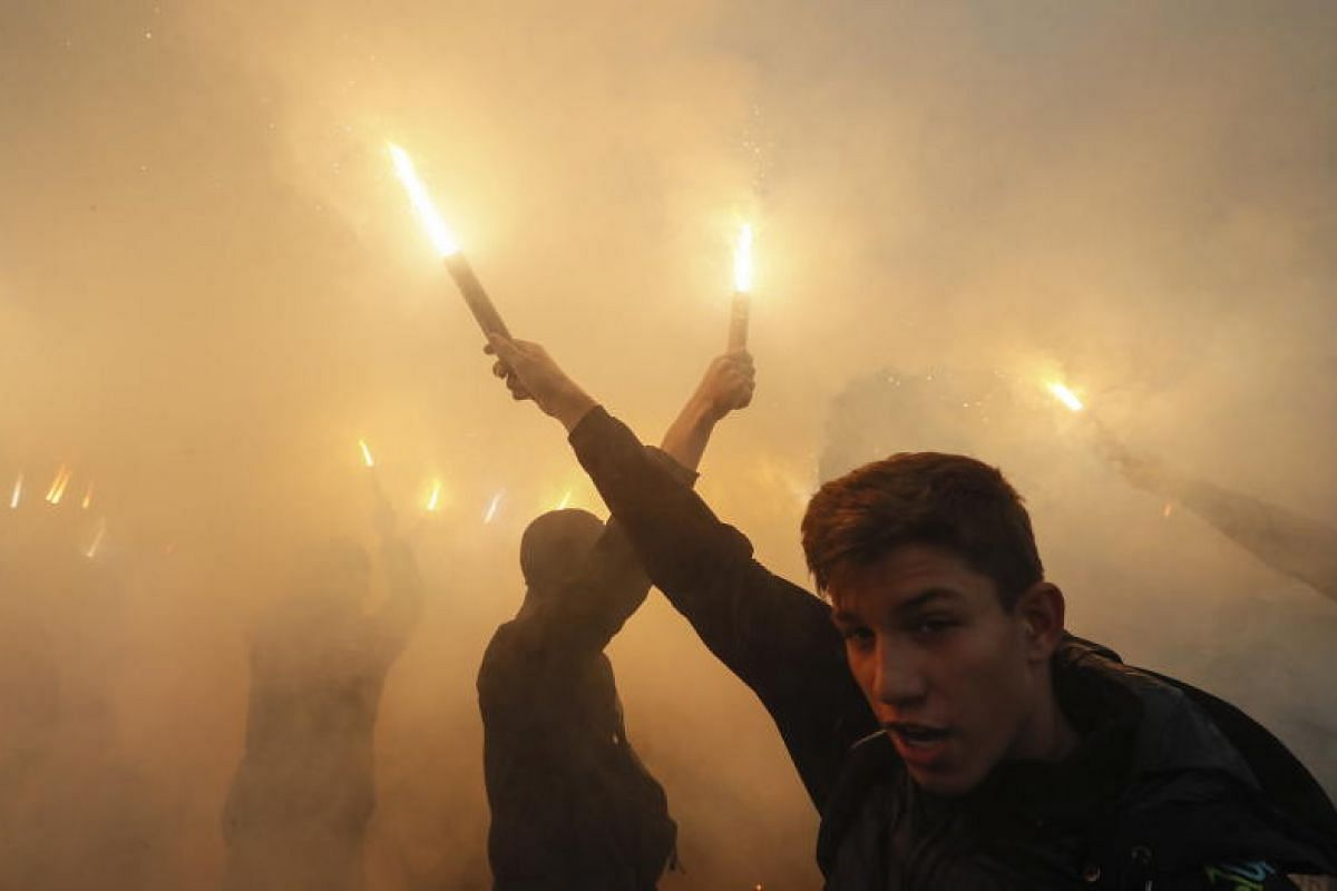 Activists and supporters of Ukrainian nationalist parties burn flares, torches and smoke grenades during their march to mark the 76th anniversary of the creation of the Ukrainian Insurgent Army (UPA), in downtown Kiev, Ukraine.The UPA fought for Ukra