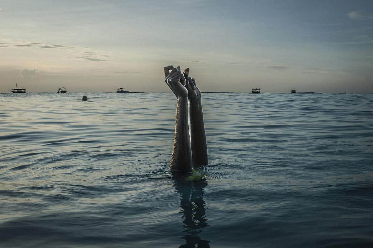 Swim instructor Chema, 17, snaps her fingers as she disappears underwater on Dec 28, 2016, in Nungwi, Zanzibar.