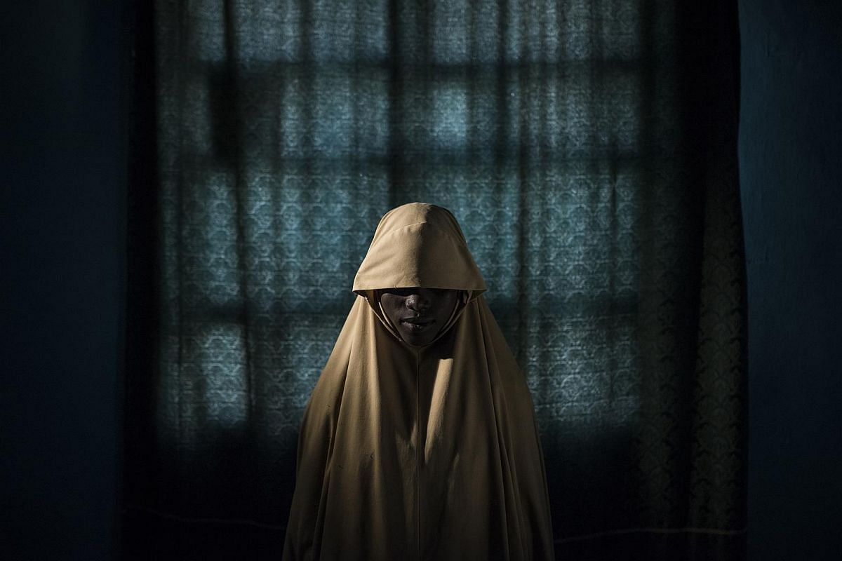 Aisha, 14, stands for a portrait in Maiduguri, Borno State, Nigeria on Sept 21, 2017. Aisha was kidnapped by Boko Haram then assigned a suicide bombing mission. After she was strapped with explosives, she found help instead of blowing herself and oth