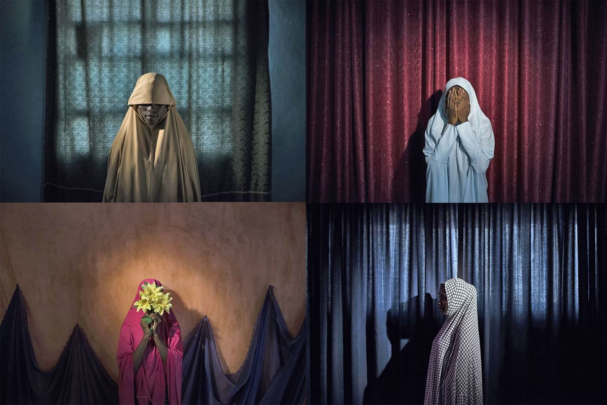 Portraits of girls kidnapped by Boko Haram militants, taken in Maiduguri, Borno State, Nigeria, last September. Clockwise from top left: Aisha, 14; Maryam, 16; Balaraba, 20; and Falmata, 15. The girls were strapped with explosives and ordered to blow