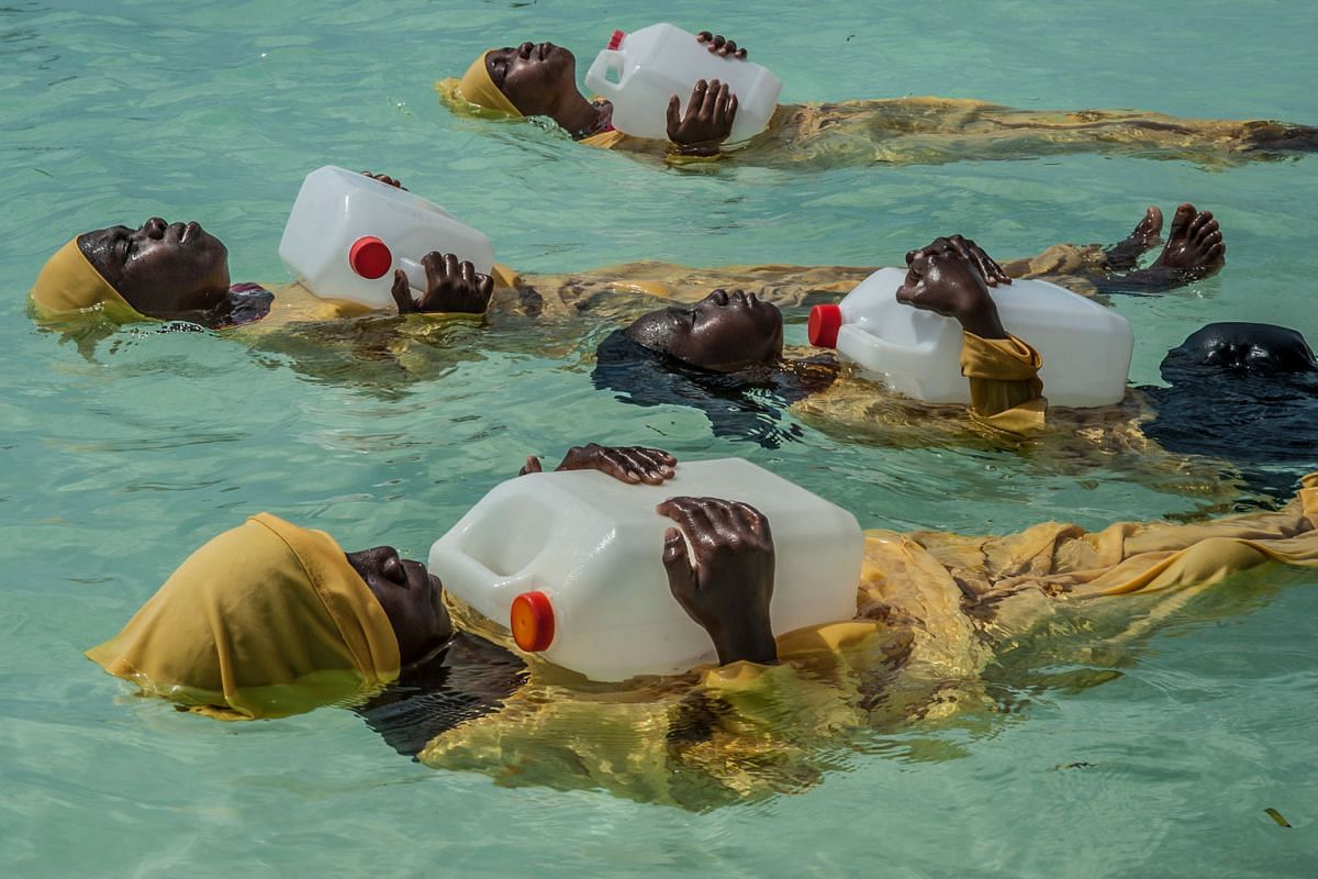 Kijini Primary School pupils learning to float, swim and perform rescues in the Indian Ocean off of Mnyuni, Zanzibar. Daily life in the Zanzibar Archipelago centres on the sea, yet the majority of girls who inhabit the islands never acquire even the