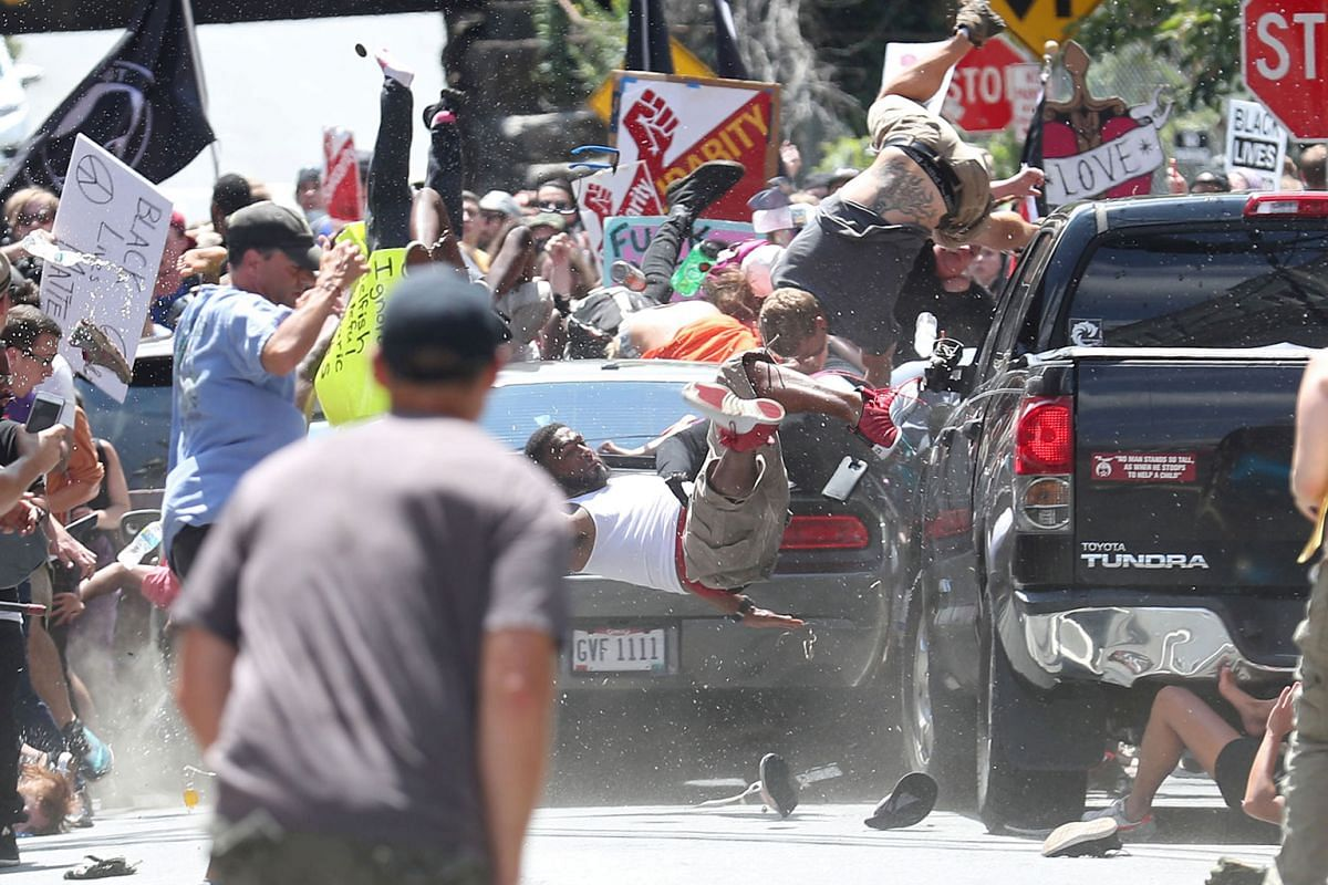 People are thrown into the air as a car ploughs into a group of protesters demonstrating against the Unite the Right rally in the US city of Charlottesville, Virginia, on Aug 12 last year. The attack killed one and injured 19 others. James Alex Field