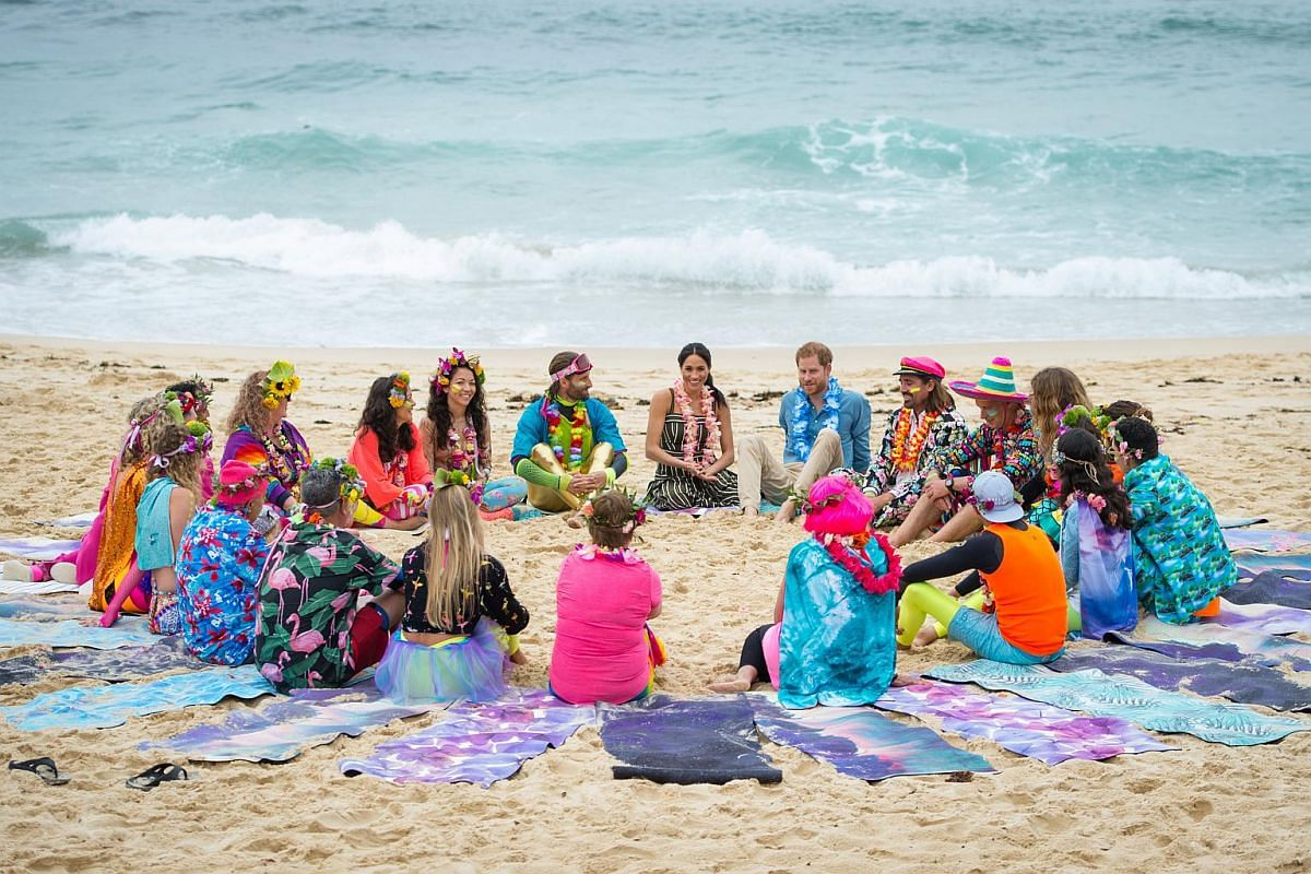 Britain's Prince Harry and his wife Meghan, Duchess of Sussex, meet participants of Fluro Friday at Bondi Beach in Sydney, on Oct 19, 2018.
