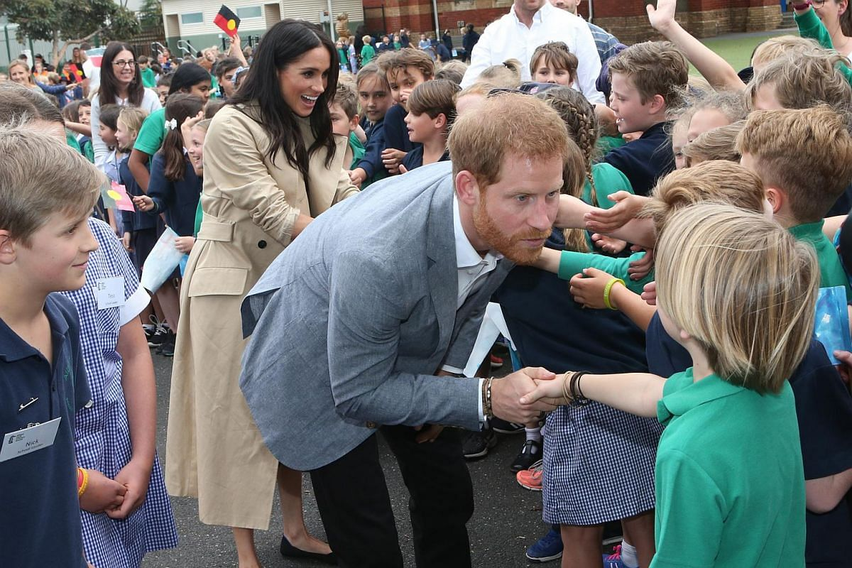 Britain's Prince Harry and his wife Meghan, the Duchess of Sussex visit the Albert Park Primary School in Melbourne, Australia, on Oct 18, 2018.