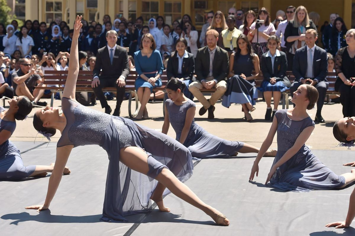 Britain's Prince Harry and his wife Meghan, Duchess of Sussex watch a dance performance on a visit to Macarthur Girls High School in the west of Sydney on Oct 19, 2018.