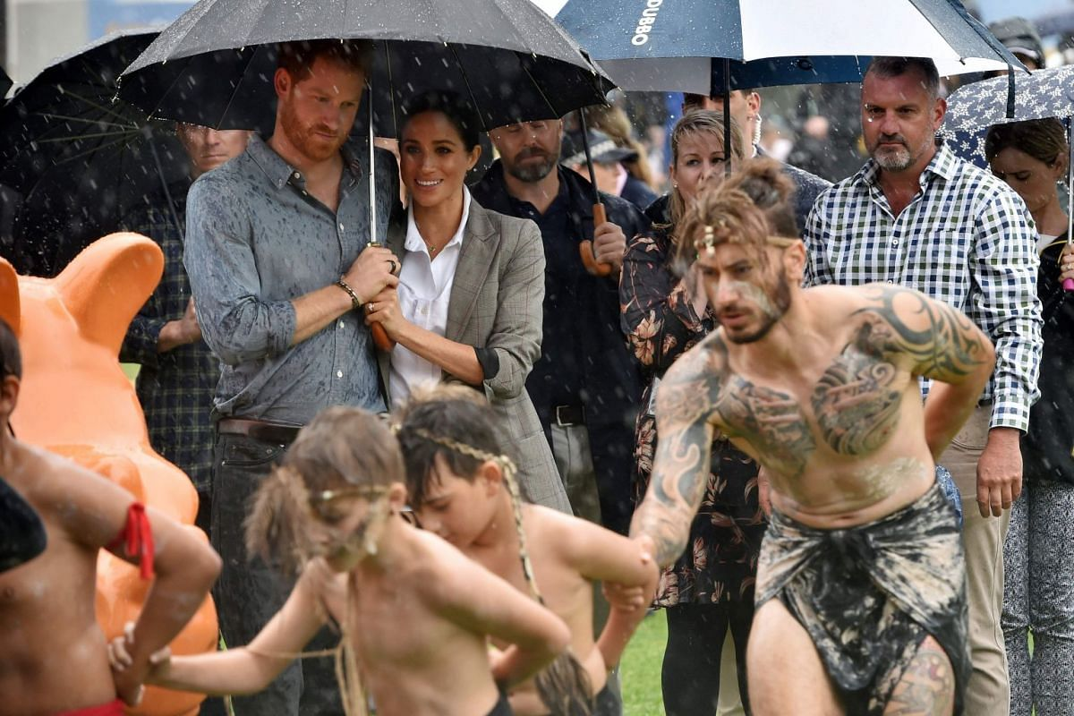 Britain's Prince Harry and his wife Meghan, Duchess of Sussex, watch aboriginal dances at Victoria Park in Dubbo on Oct 17, 2018.