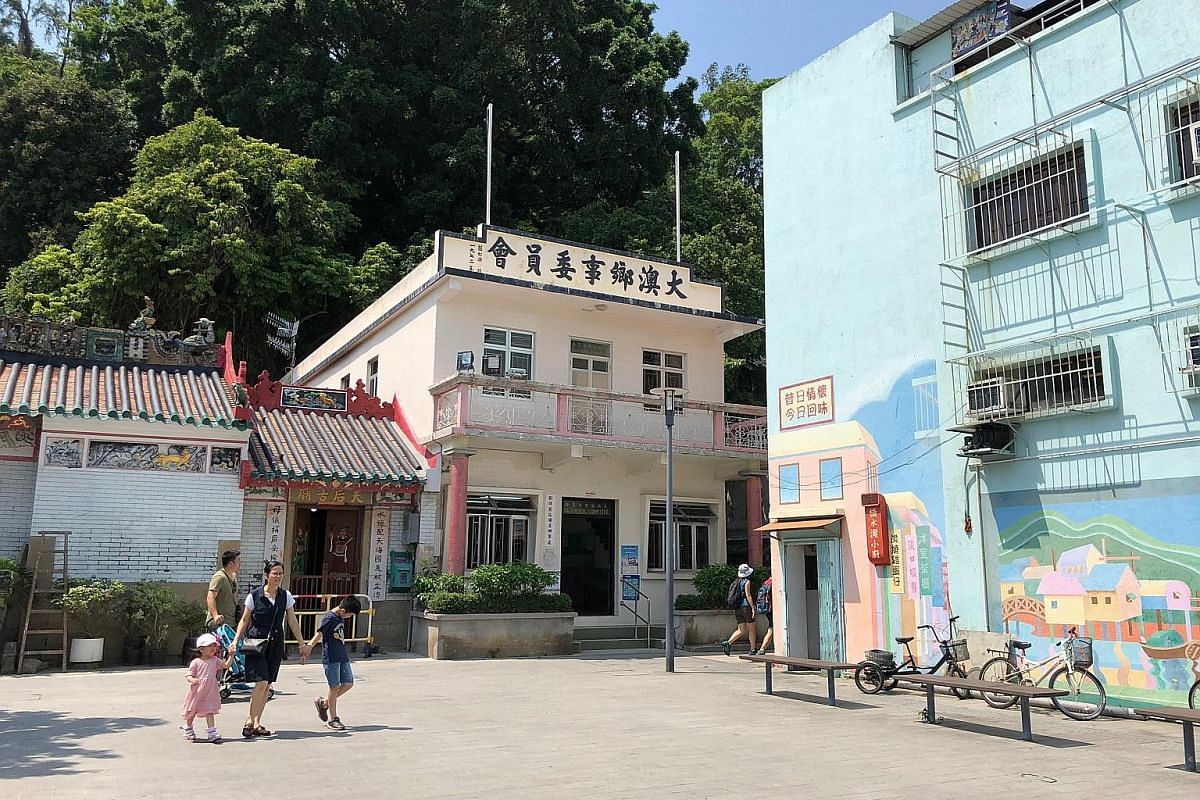 Left: Tai O's temple, rural committee office and school are located in the same area, a reflection of the community's close-knit ties. Below: The name Tai O refers to water channels and the once-bustling village that was one of Hong Kong's most vital