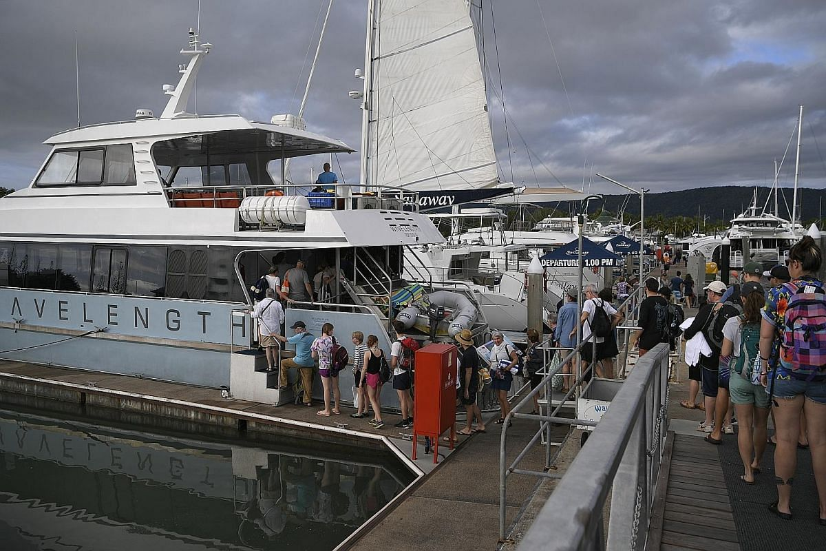 At Port Douglas, tourists board their boats for cruises out to the Great Barrier Reef for diving or snorkelling.