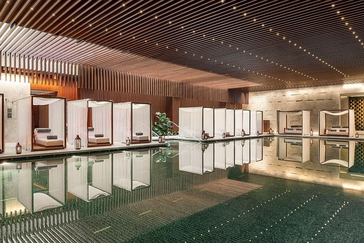 The pool at Bvlgari Hotel Shanghai. The hotel, which opened in June, is a restored Chamber of Commerce building in Shanghai built in 1916. The hipster Tianzifang shopping area is where to find shikumen, or preserved heritage alley lane houses. An art