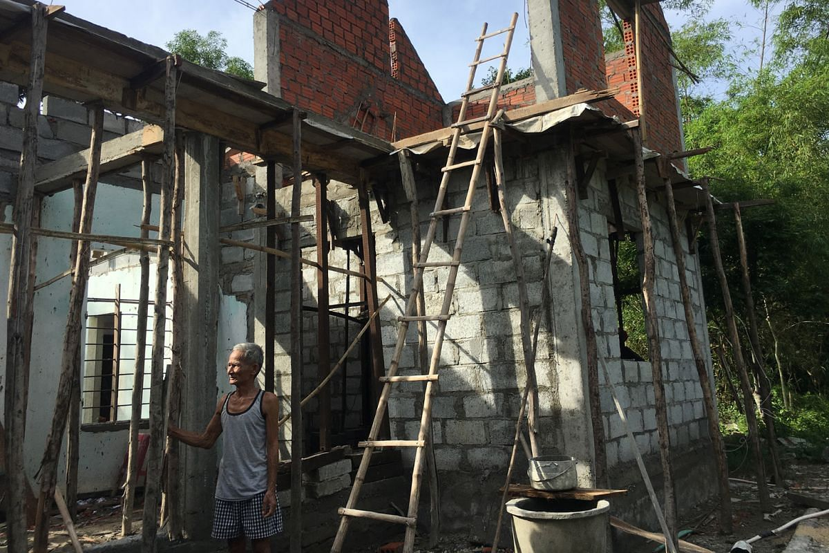 Mr Tran Dang building a new house in Vietnam, where many have lost homes due to climate change.