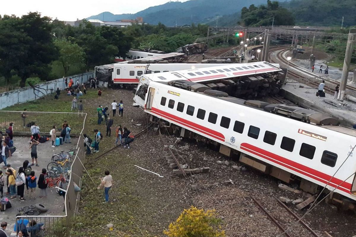 This CNA handout picture taken on October 21, 2018 shows a derailed train in Yian, eastern Taiwan. - At least 17 people have died after a train derailed and flipped over in Taiwan, authorities said. PHOTO: HANDOUT VIA AFP