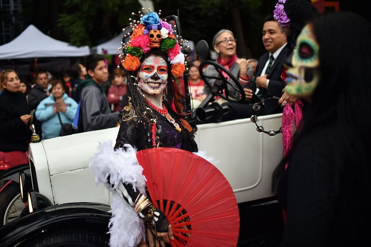 "People dressed as ""Catrina"" take part in the ""Catrinas Parade"" along Reforma Avenue, in Mexico City on October 21, 2018, ahead of the Day of the Dead.  PHOTO: AFP"