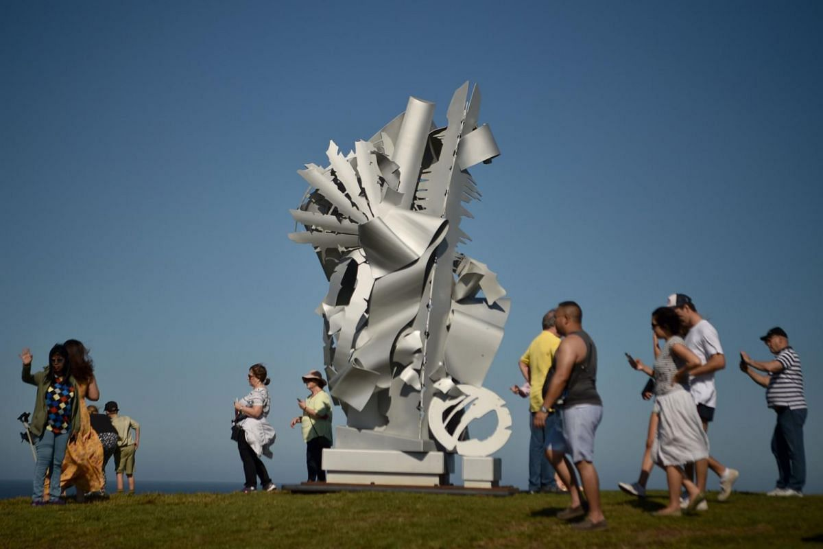 Visitors walk around a sculpture that is part of the annual Sculpture by the Sea exhibition in Sydney, on Oct 19, 2018.