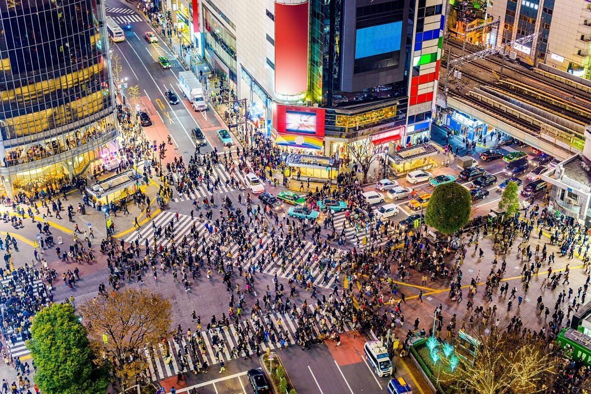 THEN AND NOW (from left): •An aerial view of Shibuya Crossing in the early 1950s, when the Hibari-go cable car was in operation. The crossing has become the symbol of Tokyo. It is said that over 500,000 people cross it each day. •Street c