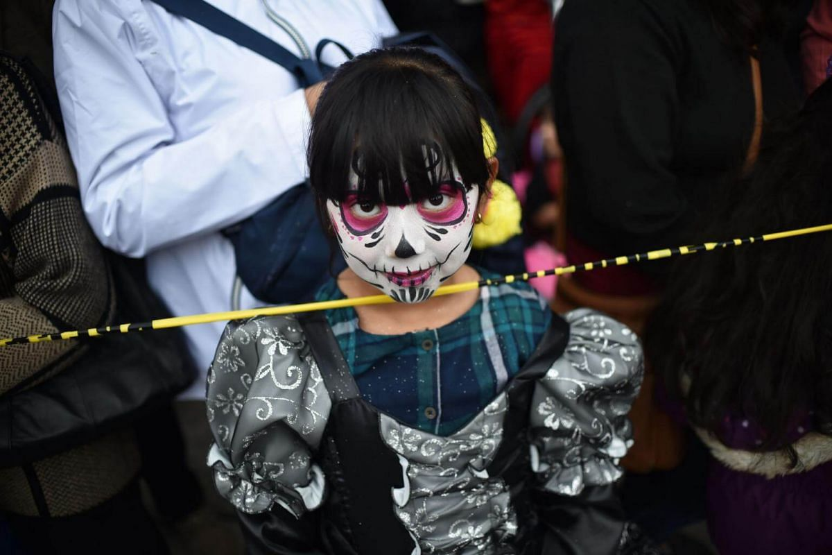 in pictures: mexicans dress up for catrina parade ahead of day of