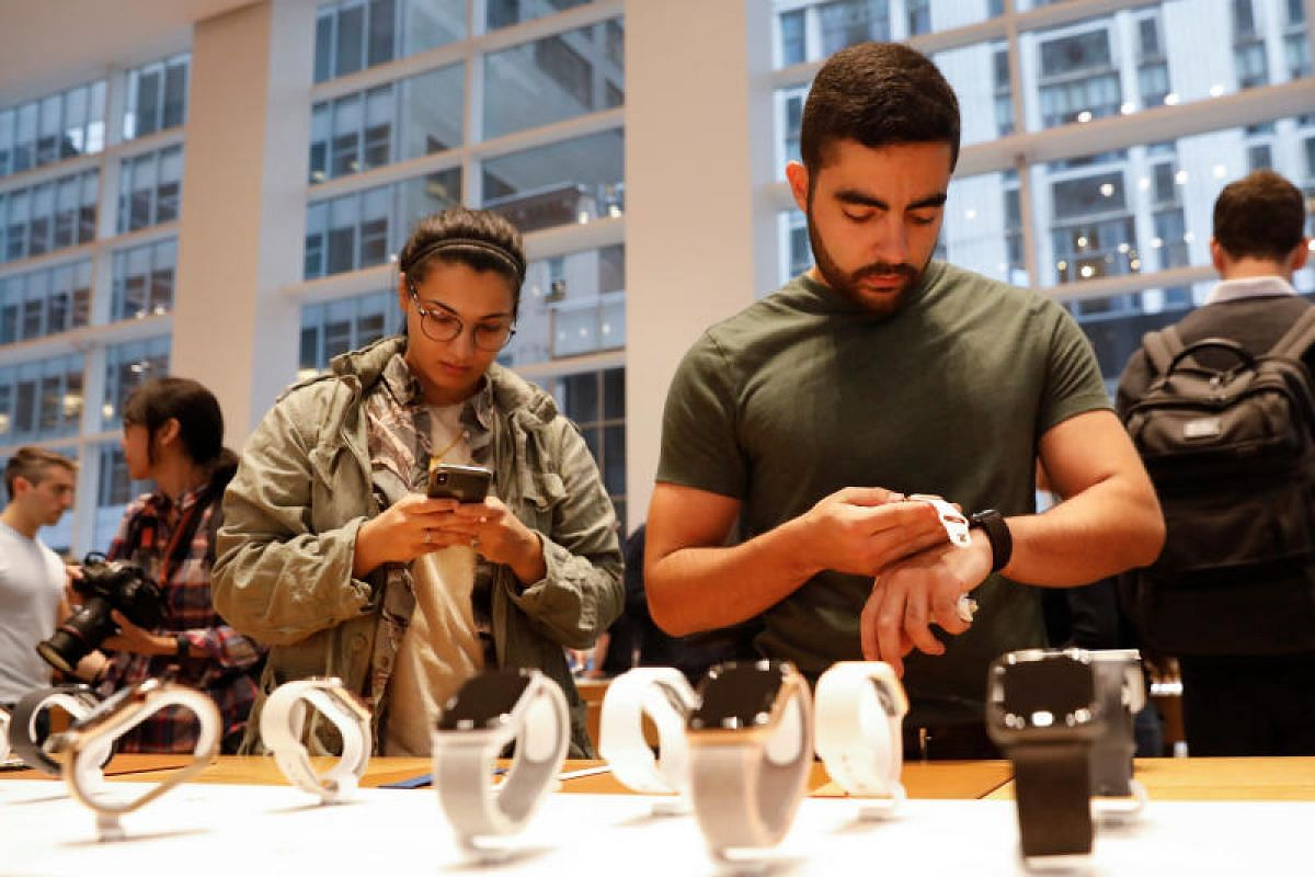 A man tries on the new Apple Watch Series 4 at the Apple Store in Manhattan, New York, on Sept 21, 2018.