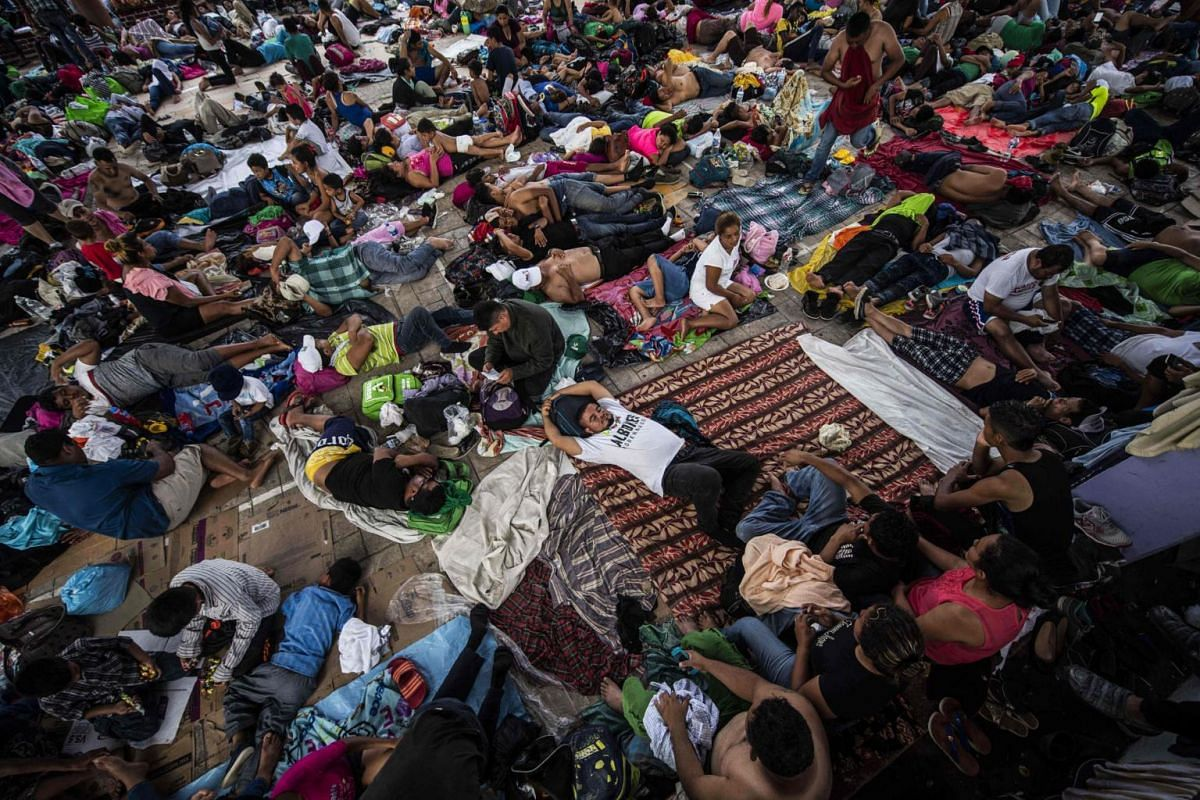 Honduran migrants rest during a stop in Mapastepec, Chiapas state, Mexico, on Oct 24, 2018.