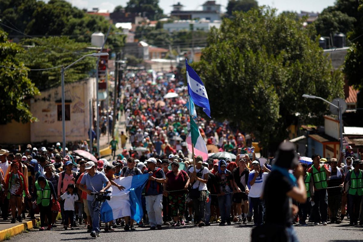 Honduran migrants walk on a street as they continue their journey in Tapachula, Mexico, on Oct 22, 2018.