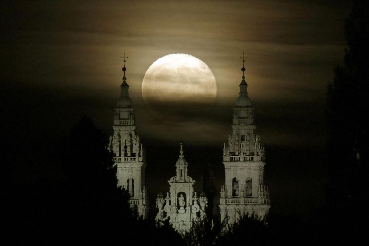 The full moon shines over the Santiago de Compostela Cathedral in Santiago de Compostela, Galicia, northern Spain on, Oct 25, 2018.