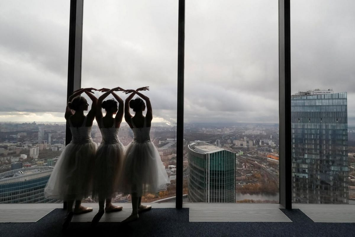 """Ballerinas perform during an ice-cream factory promotional event at an observation floor of the Moscow International Business Centre, also known as """"Moskva-City"""", in Moscow, Russia, Oct 25, 2018."""