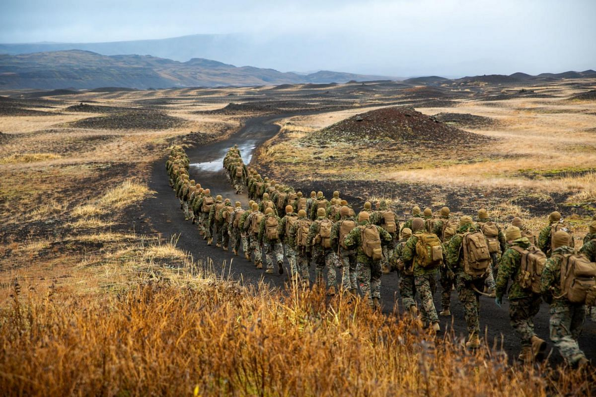 US Marines with the 24th Marine Expeditionary Unit, deployed during Exercise Trident Juncture 18, hike to a cold-weather training site in Iceland, on Oct 19, 2018.