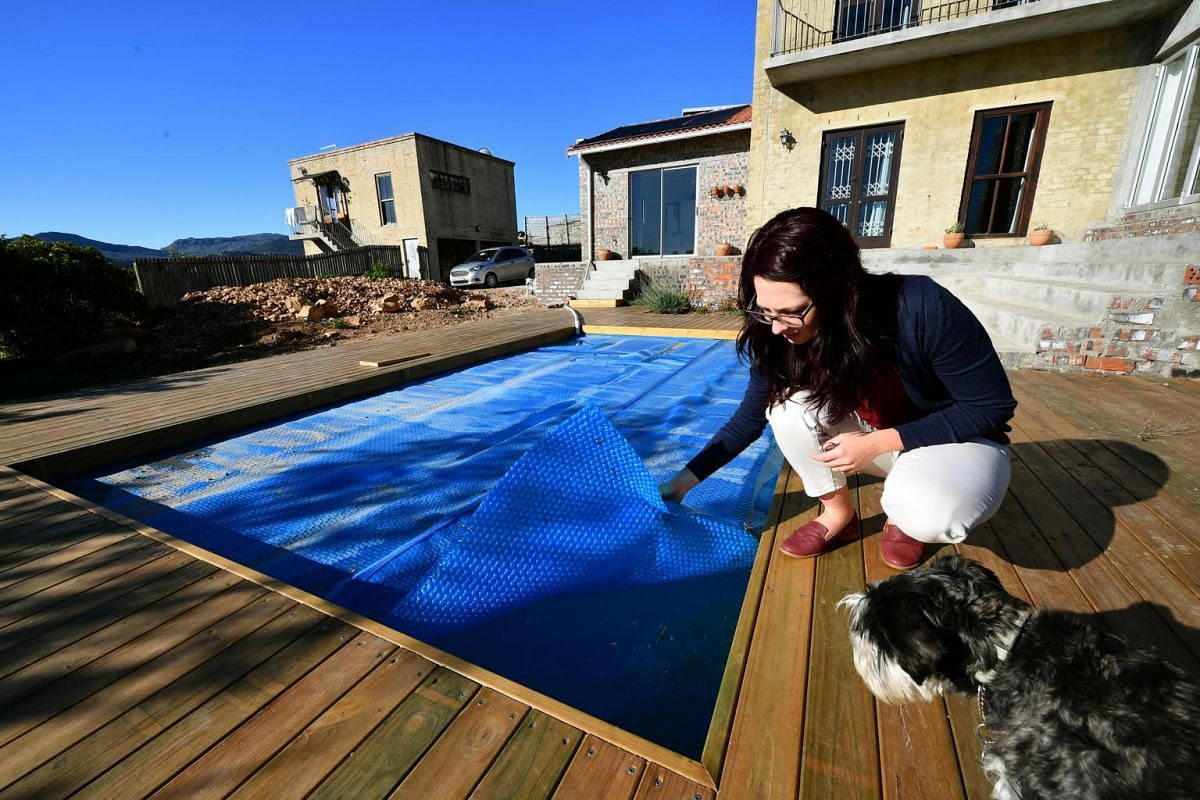 Cape Town resident Bronwyn Kerswill at her landlord's house, where the swimming pool was used to store non-potable water from a spring with high mineral content.
