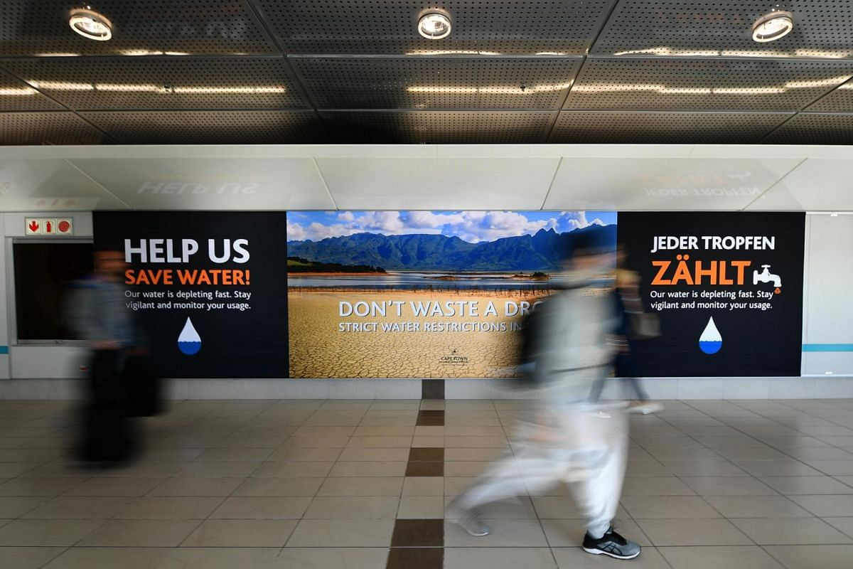 A banner extolling people to save water at Cape Town International Airport, on June 4, 2018.