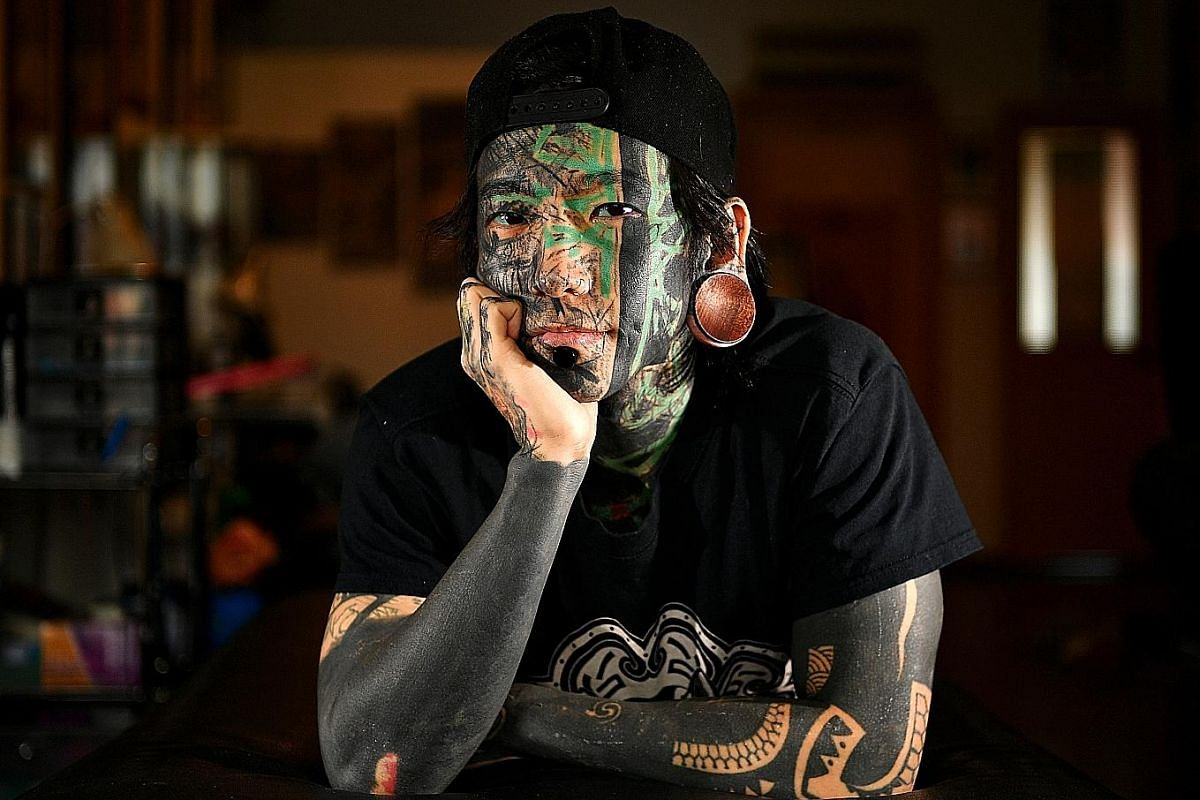 Besides a full face tattoo, most of tattoo artist Akira Ong's neck, arms and legs are also covered in ink.