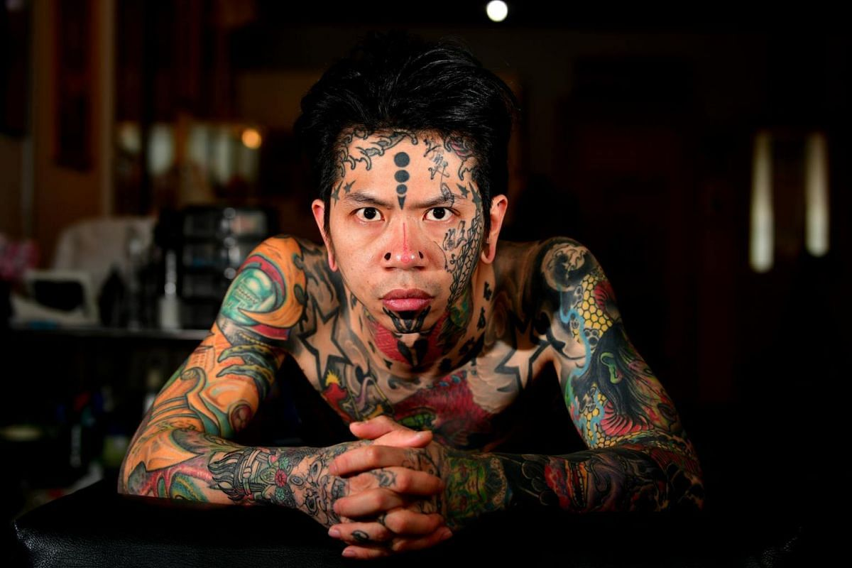 Baldwin Chew, 32, founder of Horikawa Tattoos, has tattoos on his forehead, nose and the sides of his face.