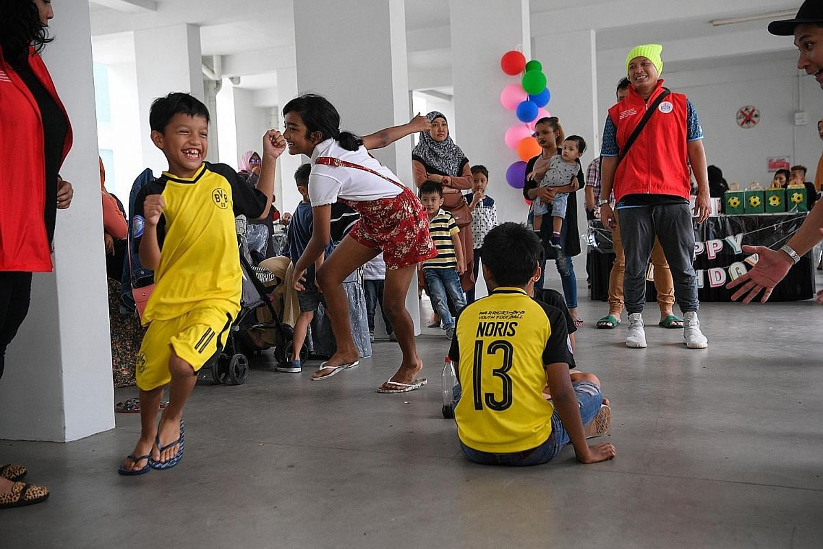 Mr Lubis Ratno (in red vest) keeping an eye on the children as they play games at a party held earlier this month.