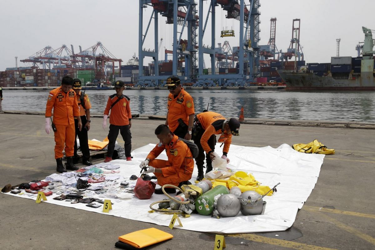 Indonesian rescuers collect and classify wreckage and passenger belongings at Tanjung Priok Harbour, Jakarta, on Oct 30, 2018.