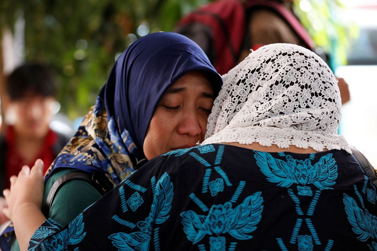 Relatives of passengers on the crashed Lion Air Flight JT610 cry at Bhayangkara R. Said Sukanto hospital in Jakarta on Oct 30, 2018.